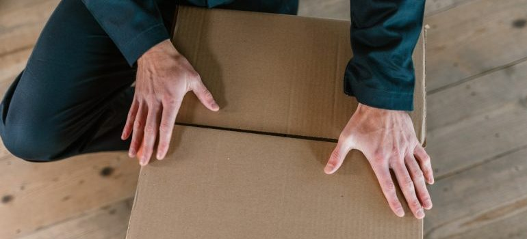 movers with a box, representing delivery service northern virginia