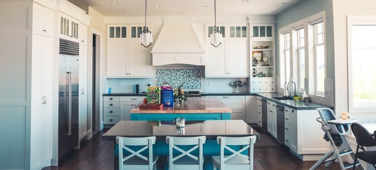 A kitchen with blue details.