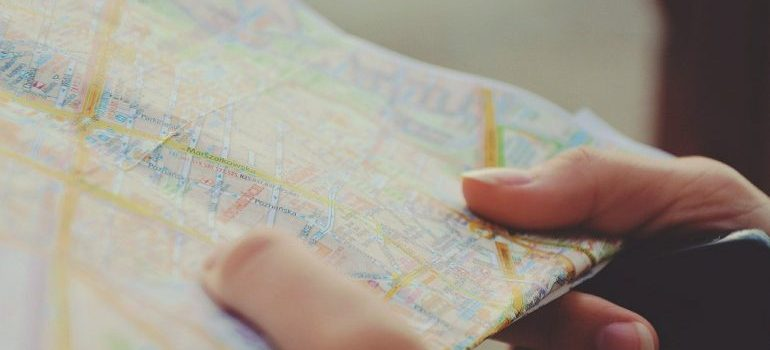A person holding a map.