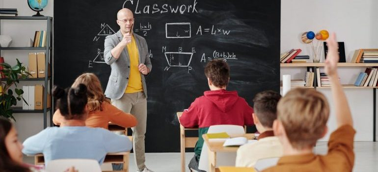 Teacher and kids in the classroom