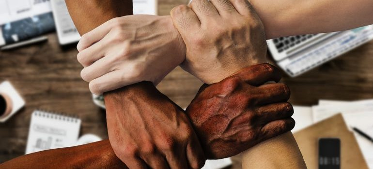 An image of people holding hands, representing team building.