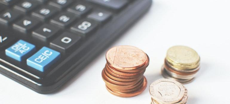 Coins beside a calculator