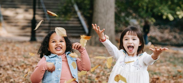 Kids play with leaves.